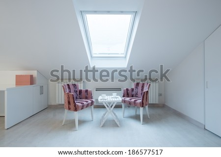 Interior of a bright white cozy loft in luxury apartment - place for relaxation - stock photo