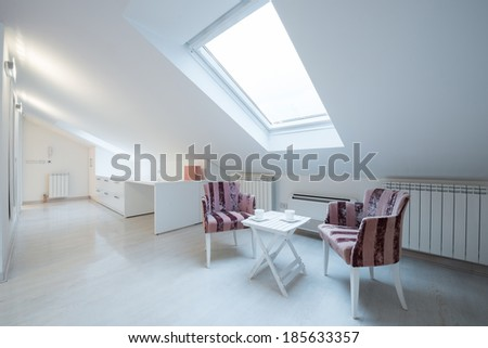 Interior of a bright white cozy loft in luxury apartment - place for relaxing - stock photo