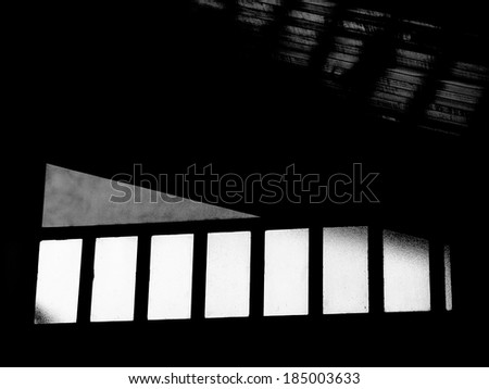interior of a building showing windows and the ceiling - stock photo