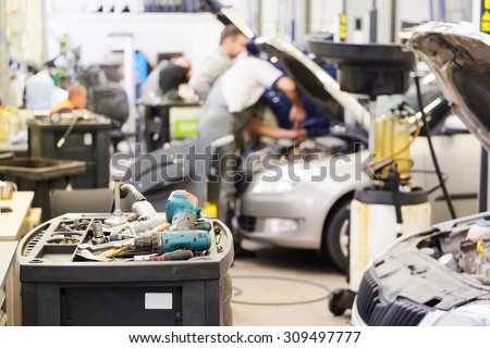 Interior of a car repair shop - stock photo