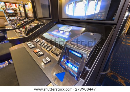 Interior of a casino with slot machines  - stock photo