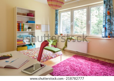 Interior of a children room with big window - stock photo