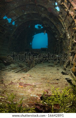 Interior of a crashed World War II Betty Bomber,  underwater in Micronesia. - stock photo