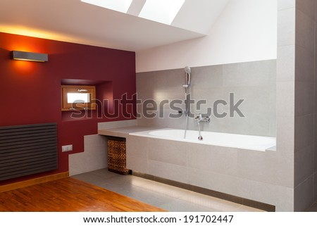 Interior of a designed and modern bathroom - stock photo