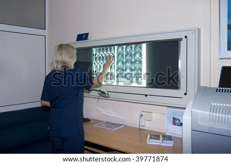 Interior of a doctor room with doctor joint specialist whatching film. - stock photo