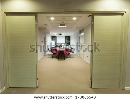 Interior of a hallway with a view to a boardroom - stock photo