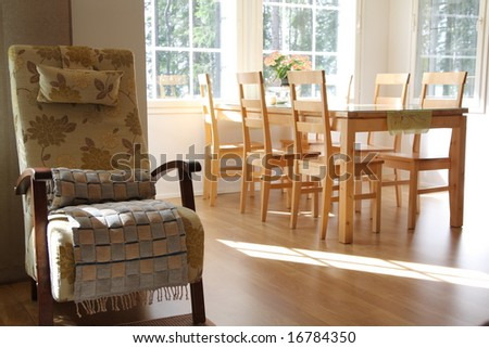 Interior of a home, armchair and dining room - stock photo