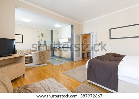 Interior of a hotel apartment with kitchen - stock photo