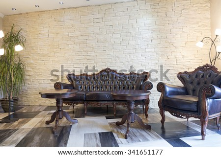 Interior of a hotel lobby with luxury leather furniture - stock photo