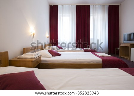 Interior of a hotel room with three beds - stock photo