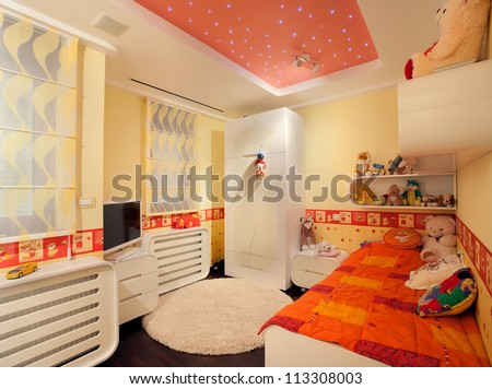 Interior of a kid room, modern design, with furniture and toys all around. - stock photo