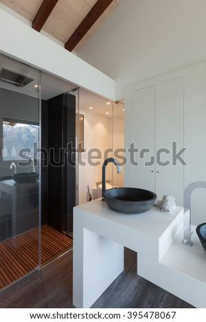 Interior of a loft, bathroom modern design, sink and shower - stock photo
