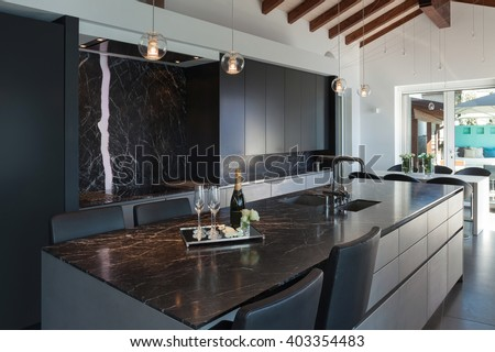 Interior of a loft, kitchen with marble counter top, modern design - stock photo
