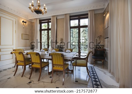 Interior of a luxury dinning room - stock photo