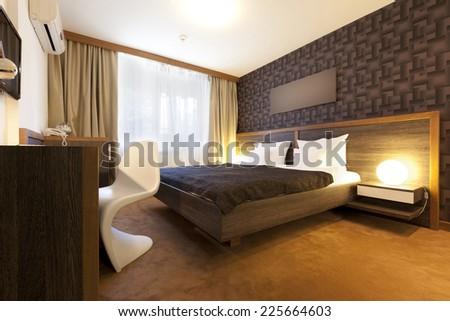 Interior of a luxury hotel bedroom - stock photo