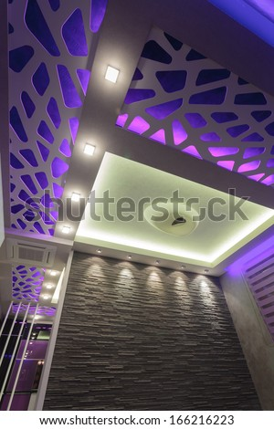 Interior of a luxury living room,  illuminated only ceiling lamps  - stock photo
