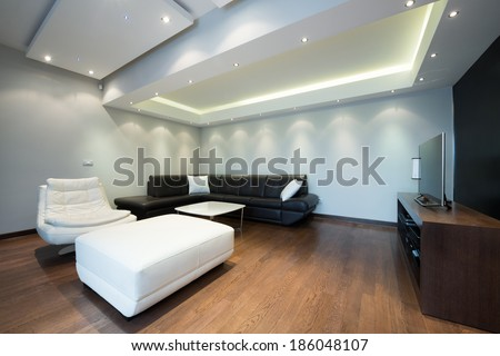 Interior of a luxury living room with beautiful ceiling lights - stock photo