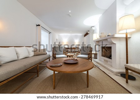 Interior of a luxury living room with fireplace - stock photo