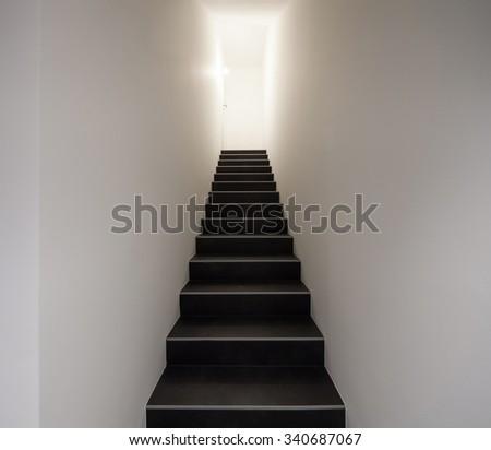 Interior of a modern apartment, black staircase - stock photo