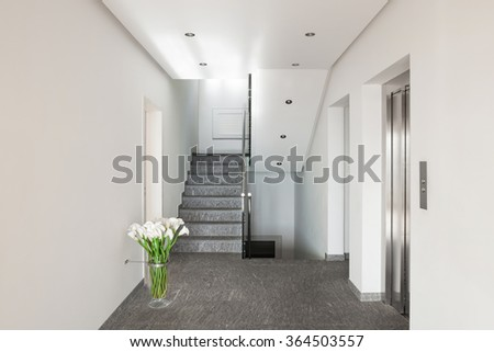 Interior of a modern apartment building, corridor with elevator - stock photo