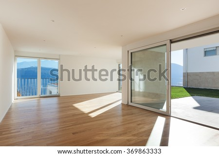 interior of a modern apartment, empty open space, hardwood floor - stock photo