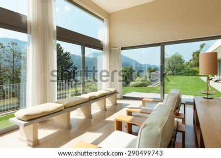 Interior of a modern apartment furnished, wide living room - stock photo