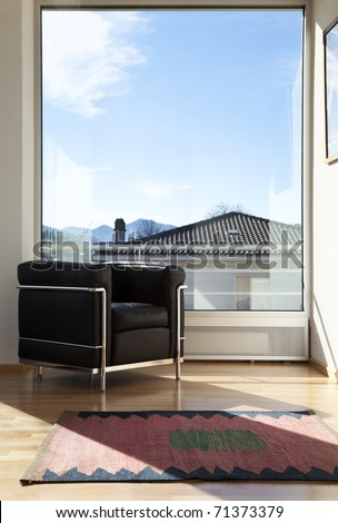 interior of a modern apartment, room with panoramic window - stock photo