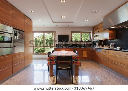Interior of a modern apartment, wide domestic kitchen, cabinet with appliances - stock photo