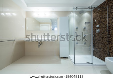 Interior of a modern bathroom with shower cabin - stock photo