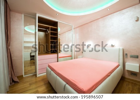 Interior of a modern bedroom with luxury ceiling  - stock photo