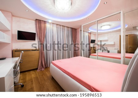 Interior of a modern bedroom with luxury ceiling lights - stock photo