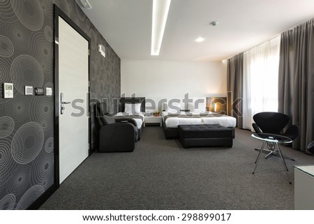 Interior of a modern hotel bedroom - stock photo