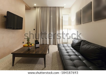 Interior of a modern hotel room in the evening  - stock photo