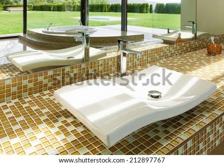 interior of a modern house, beautiful bathroom, sink - stock photo
