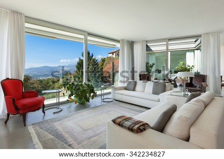 Interior of a modern house, beautiful bright living room - stock photo