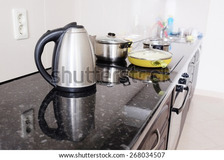 Interior of a modern kitchen. Close-up electric kettle - stock photo