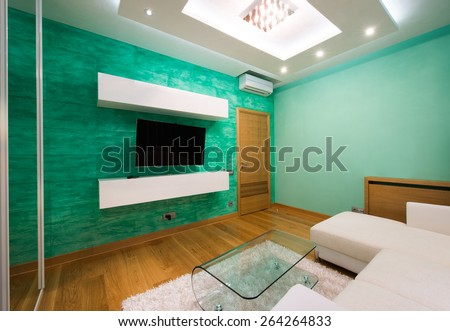 Interior of a modern living room with luxury ceiling lights  - stock photo