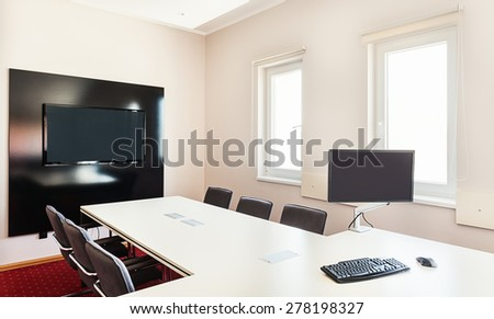 Interior of a modern office, furniture in white and computer hardware on table.  - stock photo