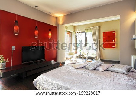 Interior of a modern red and white bedroom - stock photo