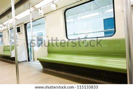 Interior of a modern subway car - stock photo