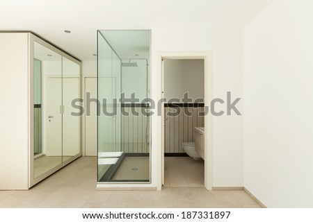 Interior of a new empty house, bathroom, shower view - stock photo