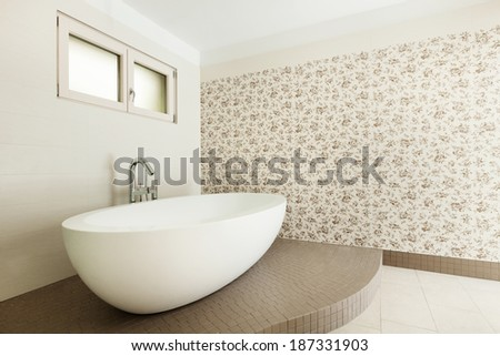 Interior of a new empty house, bathroom, view bathtub - stock photo