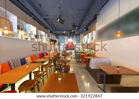 Interior of a pizza restaurant with wood fired oven - stock photo