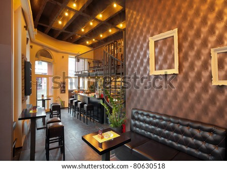 Interior of a pub with furniture during day. - stock photo