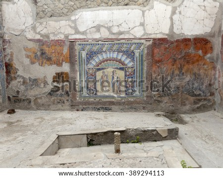 Interior of a room in a Roman villa with a wall mosaic, Herculaneum, Italy - stock photo
