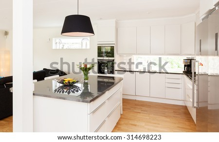 interior of a stylish kitchen with kitchen island - stock photo