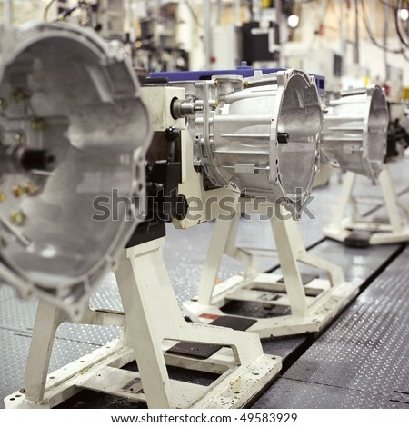 Interior of a transmissions factory. - stock photo