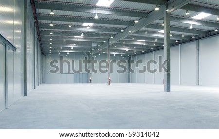 interior of a warehouse ,clean and empty - stock photo