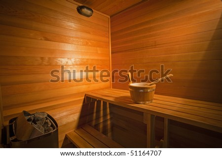 Interior of a wooden sauna - stock photo