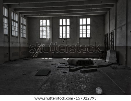 interior of an old abandoned gym - stock photo